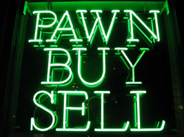 Green neon pawn shop sign